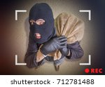 thief or robber with bag full...   Shutterstock . vector #712781488