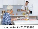 Nurse And Elderly Woman Having...