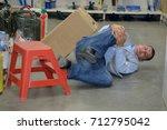 man worker with knee injury... | Shutterstock . vector #712795042