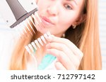the lab technician examines the ... | Shutterstock . vector #712797142