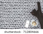 black cat sleeping on knitted... | Shutterstock . vector #712804666