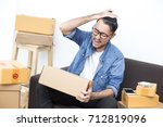 young asian man working at home ... | Shutterstock . vector #712819096