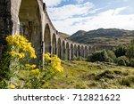 the glenfinnan viaduct is a... | Shutterstock . vector #712821622