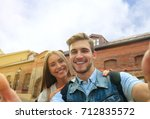 happy couple of tourists taking ... | Shutterstock . vector #712835572