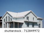 house with white roof.  white... | Shutterstock . vector #712849972
