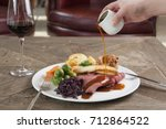 roast beef dinner with roast... | Shutterstock . vector #712864522