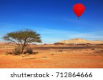 red hot air balloon flying in... | Shutterstock . vector #712864666