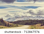 picturesque mountains of alaska ... | Shutterstock . vector #712867576
