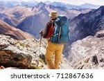 hiking scene in cordillera... | Shutterstock . vector #712867636