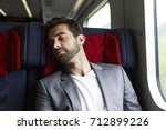 bearded dude in suit jacket... | Shutterstock . vector #712899226