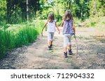children   twin girls are...   Shutterstock . vector #712904332
