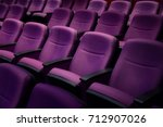 Small photo of Purple comfort seat in theater.