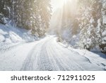 Empty Snow Covered Road In...