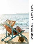 beautiful woman sunbathing in a ... | Shutterstock . vector #712911598