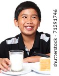 Portrait of a happy young boy holding a glass of milk. Isolated in white background. - stock photo