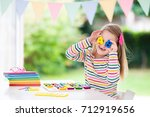 child doing homework for school ... | Shutterstock . vector #712919656