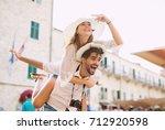 man giving a piggyback ride to...   Shutterstock . vector #712920598