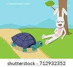 rabbit sleep under tree while... | Shutterstock .eps vector #712932352