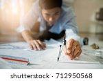 engineer asia man discussing... | Shutterstock . vector #712950568