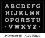vintage chalk font on a black... | Shutterstock .eps vector #712960828