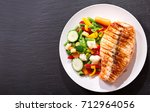 plate of grilled salmon steak... | Shutterstock . vector #712964056