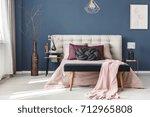 long decorative dark vase with... | Shutterstock . vector #712965808