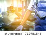 hand of car mechanic with... | Shutterstock . vector #712981846