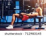 sport girl doing exercise for... | Shutterstock . vector #712983145