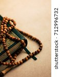 islamic rosary on a quran book  | Shutterstock . vector #712996732