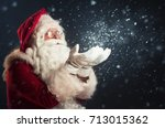 Santa Claus Blowing Magic Snow...
