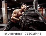shirtless man flipping heavy...   Shutterstock . vector #713015446