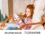 side view of little smiling... | Shutterstock . vector #713046988