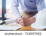 engineer sketching... | Shutterstock . vector #713057452