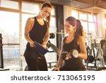 female fitness instructor... | Shutterstock . vector #713065195