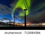 wind farm and northern lights... | Shutterstock . vector #713084386