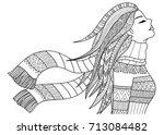 beautiful girl wearing coat and ... | Shutterstock .eps vector #713084482