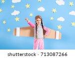 little child girl in an... | Shutterstock . vector #713087266