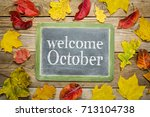 welcome october on a slate... | Shutterstock . vector #713104738