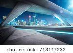 empty asphalt road under the... | Shutterstock . vector #713112232