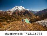 hiker is climbing to manaslu... | Shutterstock . vector #713116795