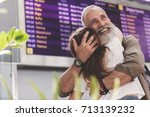 outgoing old man hugging girl... | Shutterstock . vector #713139232