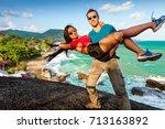 a loving couple enjoying... | Shutterstock . vector #713163892