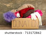 donation box with clothes.  | Shutterstock . vector #713172862
