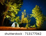 tent set on the sandy beach... | Shutterstock . vector #713177062