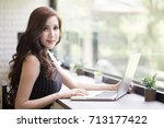 asian woman using laptop for... | Shutterstock . vector #713177422