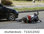 crash moto bike and car on road | Shutterstock . vector #713212432