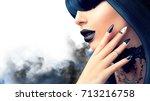 high fashion halloween model... | Shutterstock . vector #713216758