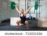 determined woman lifting... | Shutterstock . vector #713221336