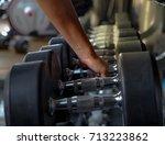 black dumbbells on rack fitness ...   Shutterstock . vector #713223862