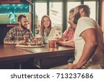 friends drinking beer and... | Shutterstock . vector #713237686